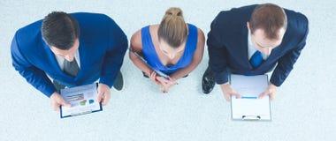 Бизнесмены стоя совместно - topview Стоковые Фотографии RF