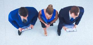 Бизнесмены стоя совместно - topview Стоковые Фото