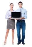 Бизнесмены с компьтер-книжкой Стоковое фото RF