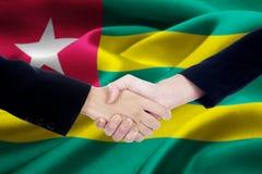 2 бизнесмены с флагом Того Стоковые Изображения