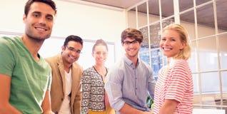 Бизнесмены усмехаясь на камере Стоковые Изображения RF