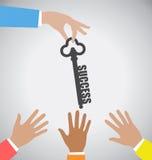 Бизнесмен давая ключу к успеху к много руку Стоковое фото RF