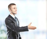 Бизнесмен давая руку Стоковые Изображения RF
