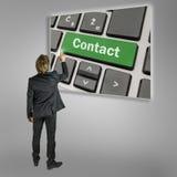 Бизнесмен активируя контакт стоковая фотография rf