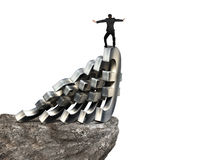 Бизнесмен балансируя на домино денег евро Стоковые Изображения RF