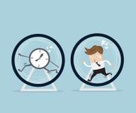 Бизнесмен бежать в колесе хомяка Стоковые Изображения RF