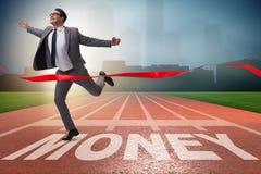 Бизнесмен бежать к деньгам на следе Стоковое фото RF