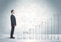 Бизнесмен взбираясь вверх в наличии нарисованная концепция диаграмм Стоковое фото RF
