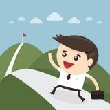 Бизнесмен взбираясь на горе Стоковая Фотография RF