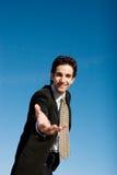 бизнесмен вне достигая Стоковое фото RF