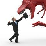 Бизнесмен воюя против динозавра Стоковые Изображения