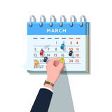 Бизнесмен вставляя штырь нажима в план-график месяца Стоковые Фотографии RF