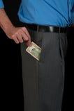 Человек вытягивая деньги от карманн Стоковые Изображения