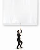 Бизнесмен вытягивая знамя Стоковые Фото
