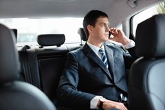 Бизнесмен в автомобиле Стоковые Фото