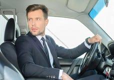 Бизнесмен в автомобиле стоковое фото rf