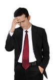 Бизнесмен в болезни, изолированной на белизне стоковая фотография rf