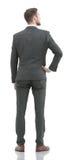 Бизнесмен в костюме от задней части - смотрящ что-то сверх Стоковое Фото