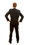 Бизнесмен в костюме от задней части Стоковое Изображение