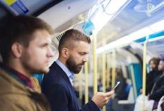 Бизнесмен в метро стоковые фото