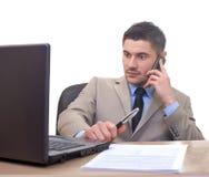 Бизнесмен в офисе Стоковое Изображение