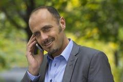 Бизнесмен в парке Стоковое Фото