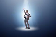 Бизнесмен в фаре в концепции дела Стоковая Фотография