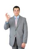 Бизнесмен делая одобренный знак Стоковое Изображение