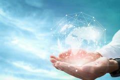Бизнесмен держа в руках с глобальной концепцией соединения стоковое изображение rf