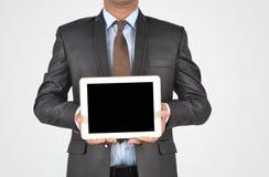 Бизнесмен держа пустой цифровой ПК таблетки, изолированное очень profe Стоковая Фотография