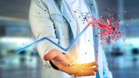 Бизнесмен держа финансовую стрелку идя вверх и explosing на Стоковое Изображение