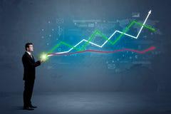 Бизнесмен держа фондовую биржу Стоковая Фотография RF