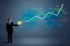 Бизнесмен держа фондовую биржу Стоковое Изображение RF