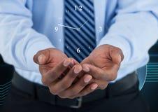 Бизнесмен держа часы против предпосылки с часами Стоковые Фотографии RF