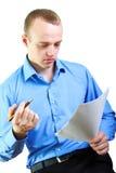 бизнесмен документирует чтение Стоковое Фото