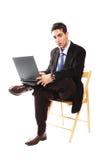 бизнесмен его компьтер-книжка стоковое изображение rf