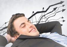 Бизнесмен лежа назад против doodle диаграммы и белой предпосылки Стоковая Фотография RF