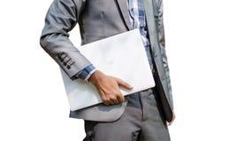 Бизнесмен держа белую компьтер-книжку стоковые изображения rf
