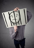 Бизнесмен держа бумагу с пленником за барами дальше i Стоковые Фотографии RF