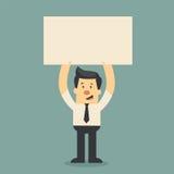 Бизнесмен держа бумагу Стоковые Изображения