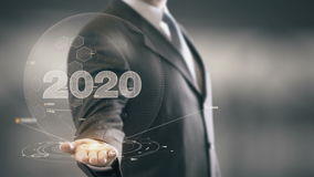 Бизнесмен 2020 держа в новых технологиях руки Стоковые Изображения