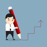 Бизнесмен держа гигантский красный карандаш и рисуя диаграмму Стоковые Фотографии RF