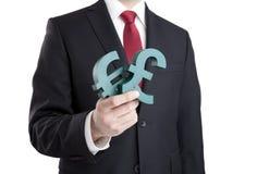 Бизнесмен держа знаки евро и фунта Стоковая Фотография RF