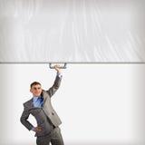 Бизнесмен держа знамя с одной рукой Стоковое Изображение RF