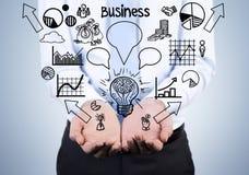 Бизнесмен держа значки дела Стоковое Фото