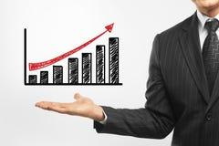 Бизнесмен держа диаграмму Стоковые Изображения