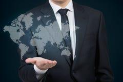 Бизнесмен держа карту мира Стоковые Фото