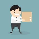 Бизнесмен держа коричневую коробку коробки Стоковое Изображение