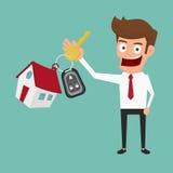 Бизнесмен держа ключевое кольцо имущество принципиальной схемы реальное Стоковое Фото
