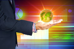 Бизнесмен держа мир дела Стоковая Фотография